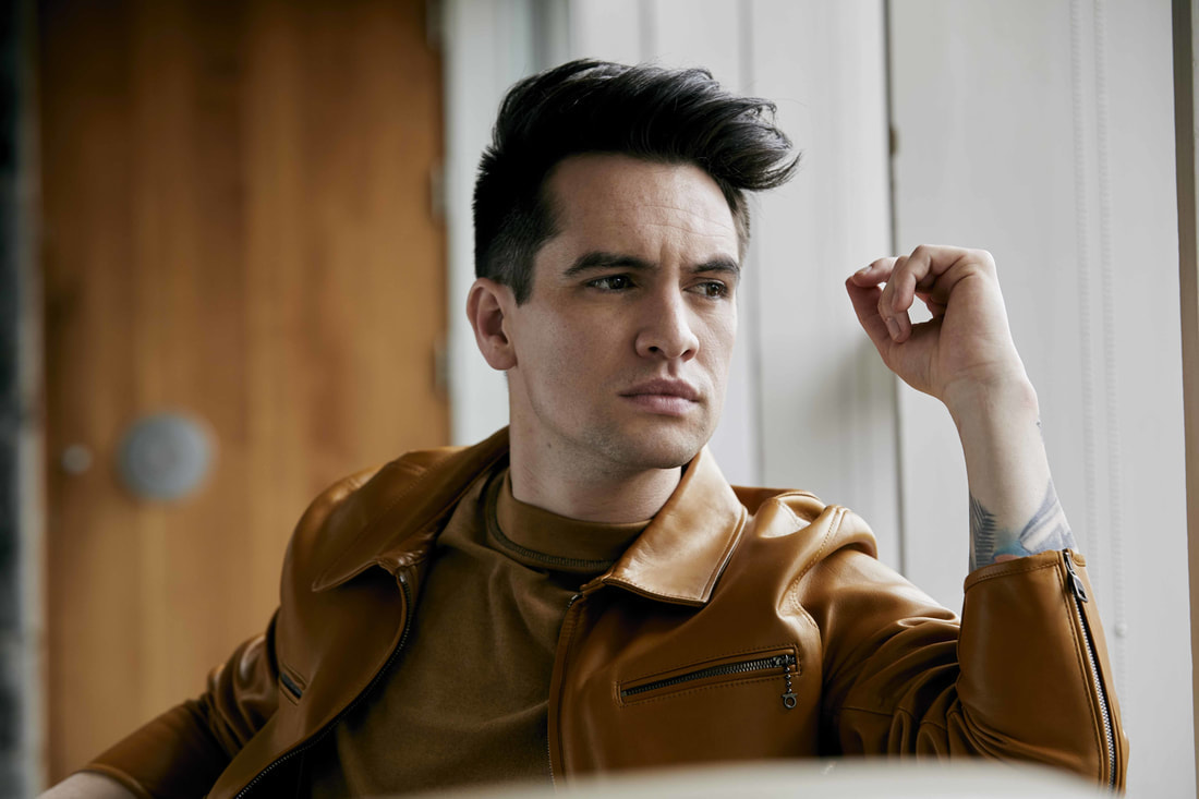 brendon-urie-interviewed-while-playing-with-puppies-talks-alternate-album-titles