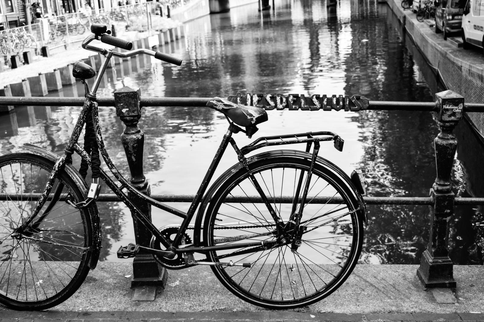 Locked bike on bridge in amsterdam