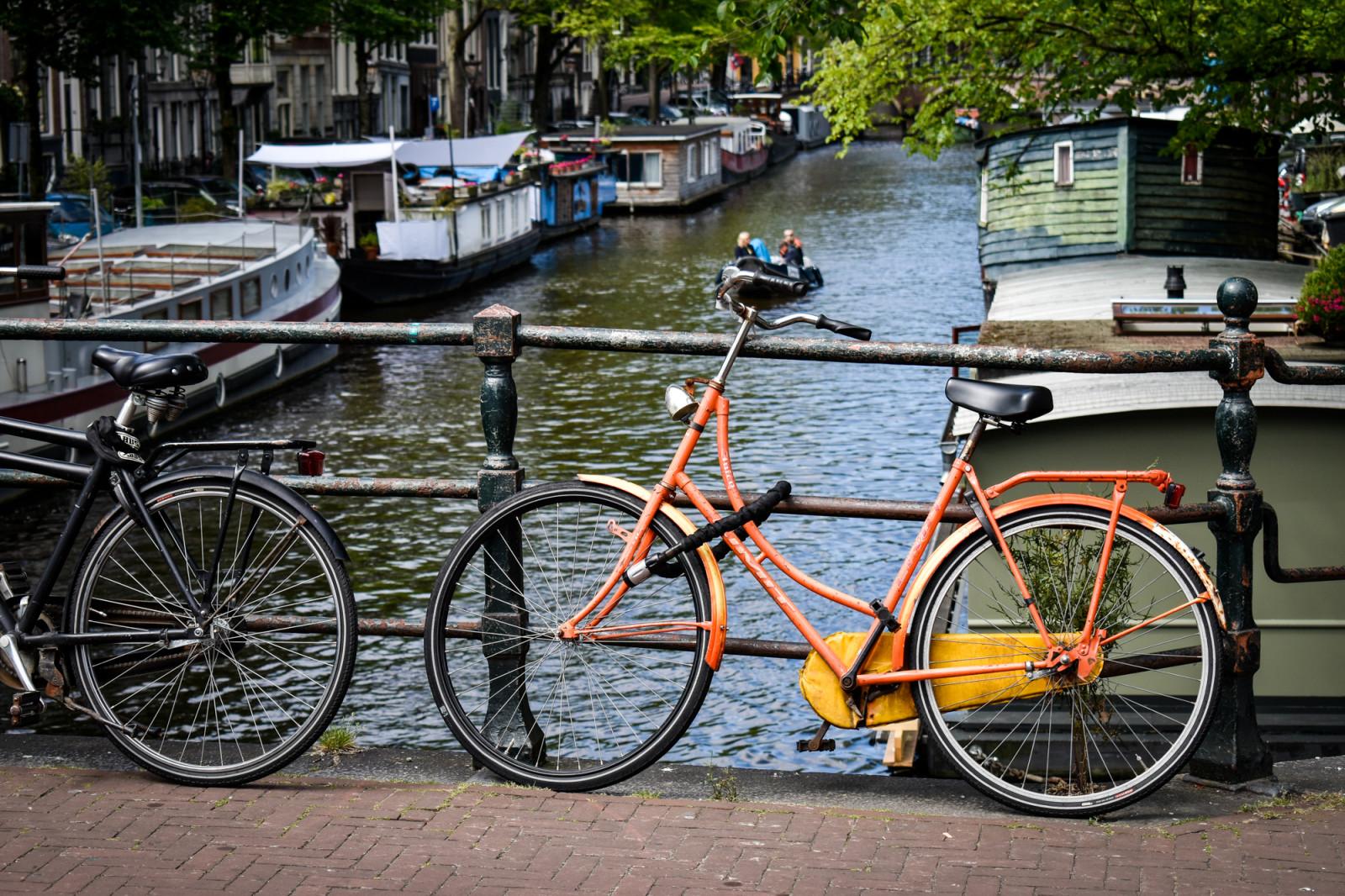 Orange bike on canals in Amsterdam