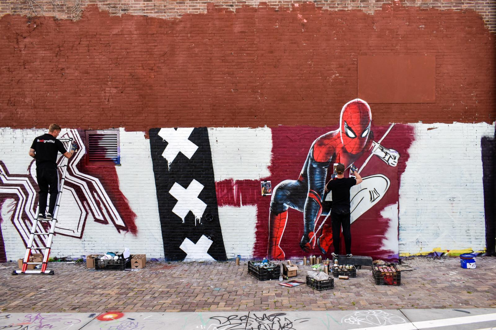 Graffiti artist painting in Amsterdam