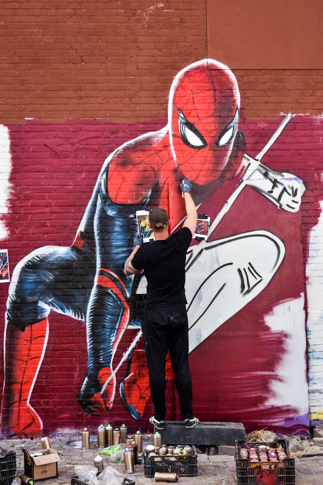 Graffiti wall art artist painting in Amsterdam
