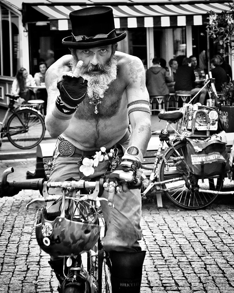 Cool dude in Amsterdam on bicycle