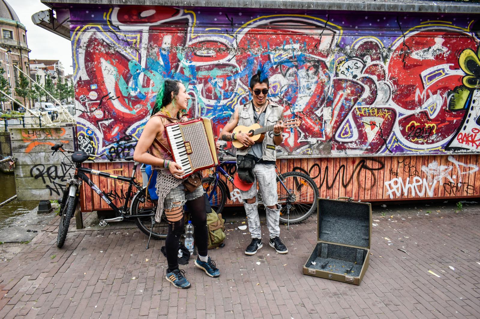 Two guys making street music in Amsterdam