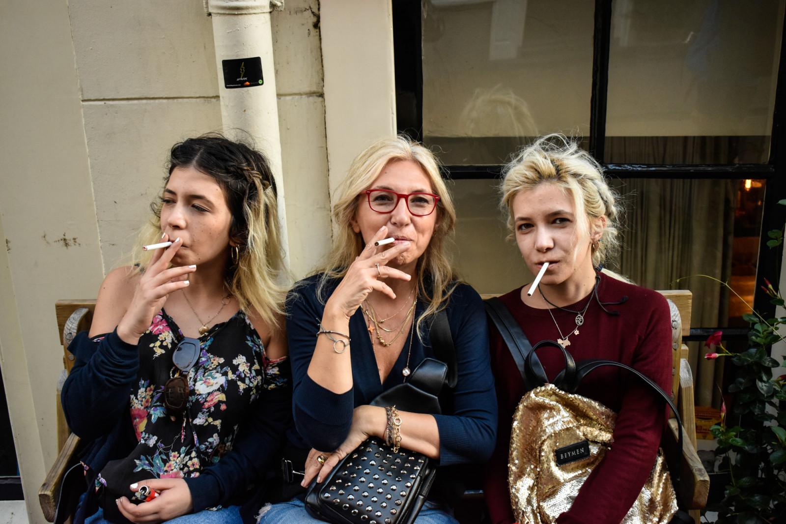 Three women smoking cigarettes in Amsterdam