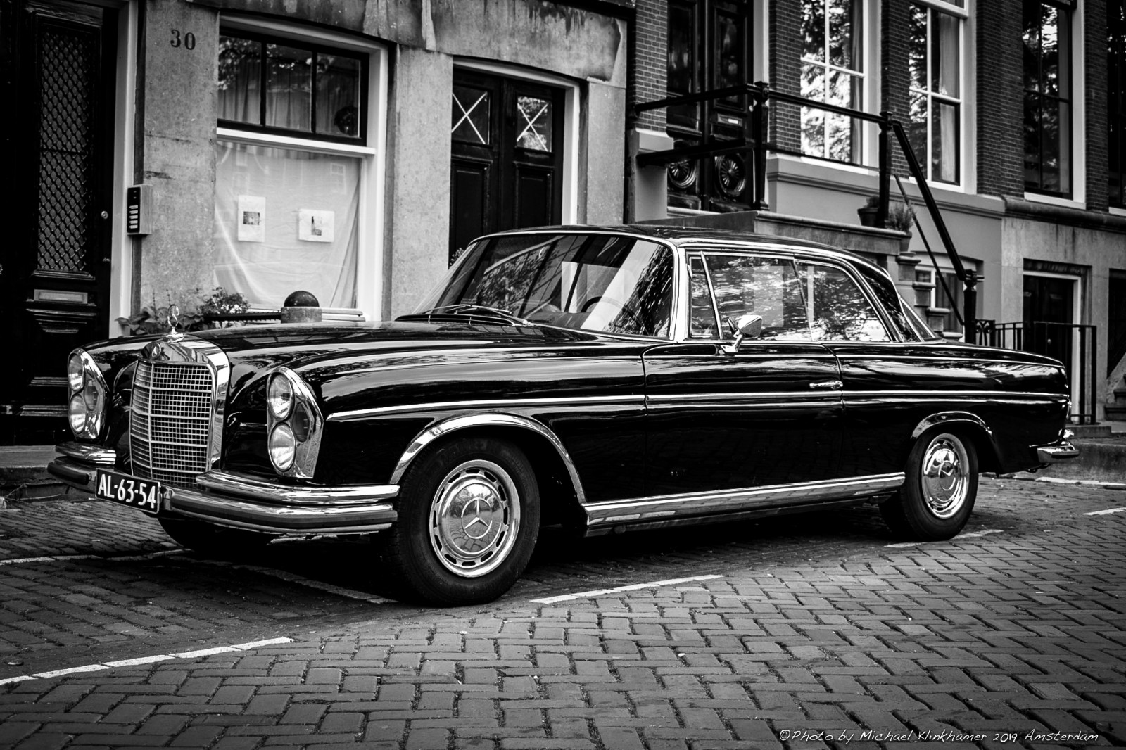 Black Mercedes Benz 280SE Coupe