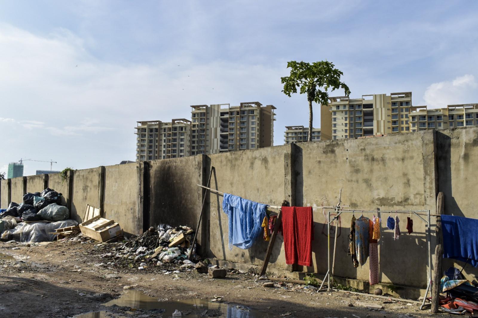 Phnom Penh city walls with garbage