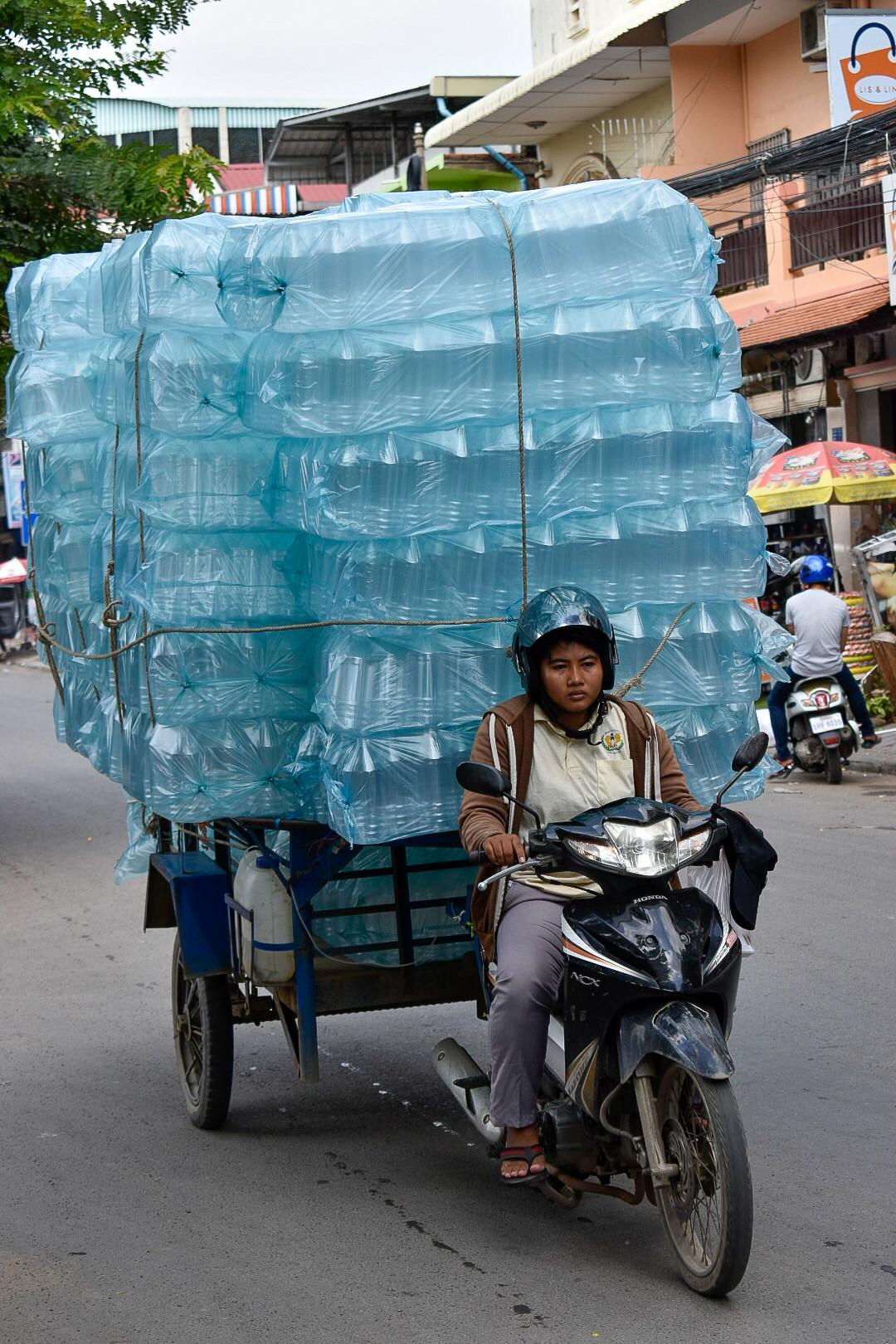 Phnom Penh plastics on motorbike