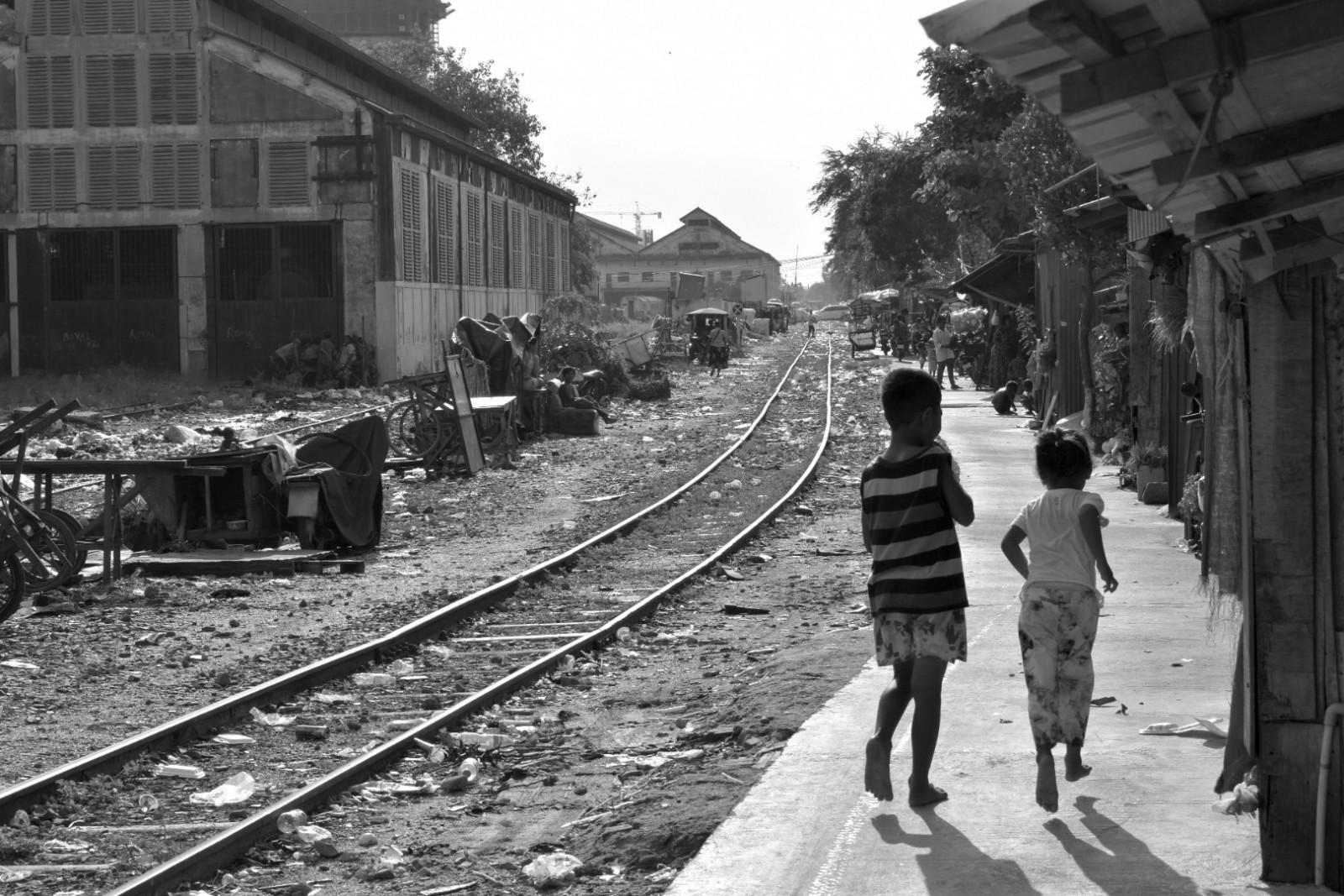 City of garbage Phnom Penh railroad tracks children playing