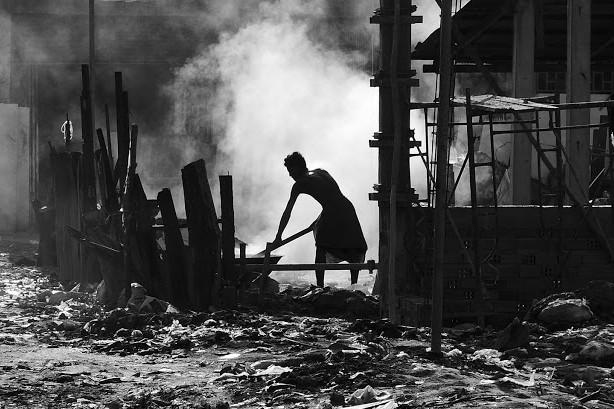 Phnom Penh slums man at work